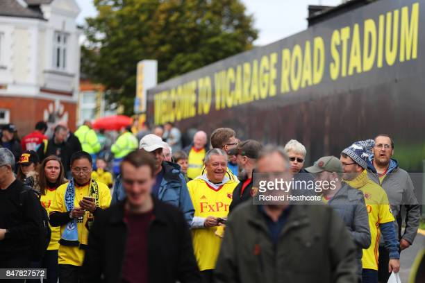 Watford fans arrive at the stadium prior to the Premier League match between Watford and Manchester City at Vicarage Road on September 16 2017 in...