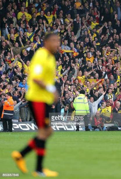 Watford fans celebrate in the stands after Watford's Troy Deeney scores a late winner