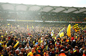 Watford fans celebrate promotion on the pitch after the Sky Bet Championship match between Watford and Sheffield Wednesday at Vicarage Road on May 2...