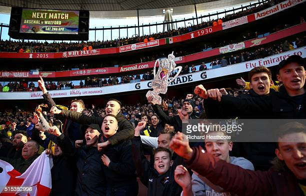 Watford fans celebrate victory after the Emirates FA Cup sixth round match between Arsenal and Watford at Emirates Stadium on March 13 2016 in London...