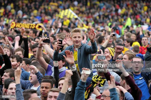 Watford fans invade the pitch as they celebrate reaching the play off final
