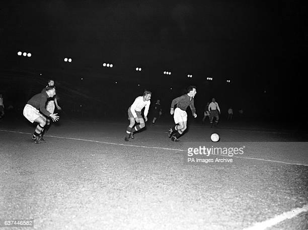 Watford goalkeeper Eddie Bennett looks on as teammate James Kelly dribbles the ball away from Hajduk Split's Slavko Lustica
