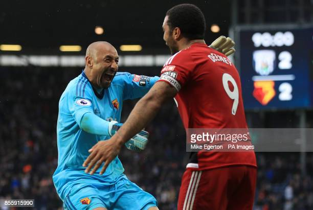 Watford goalkeeper Heurelho Gomes and Watford's Troy Deeney celebrate Richarlison's second goal of the game during the Premier League match at The...