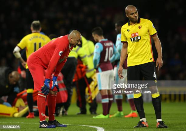 Watford goalkeeper Heurelho Gomes and Younes Kaboul react to Mauro Zarate's injury during the Premier League match at Vicarage Road Watford
