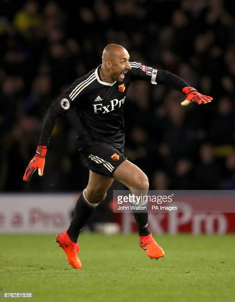Watford goalkeeper Heurelho Gomes celebrates after teammate Watford's Richarlison scores his side's second goal of the game during the Premier League...