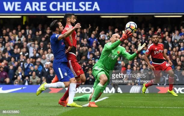 Watford goalkeeper Heurelho Gomes makes a save ahead of Chelsea's Cesc Fabregas during the Premier League match at Stamford Bridge London