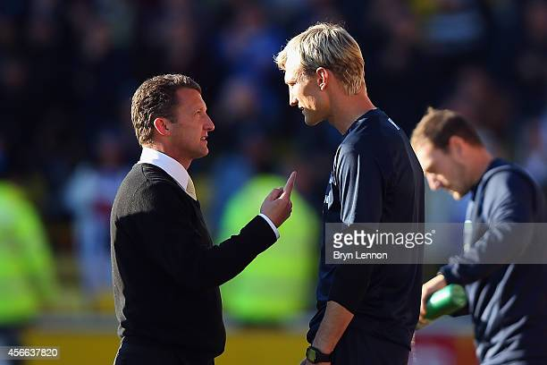 Watford Head Coach Billy McKinlay chats to Brighton Hove Albion Manager Sami Hyypia after the Sky Bet Championship match between Watford and Brighton...
