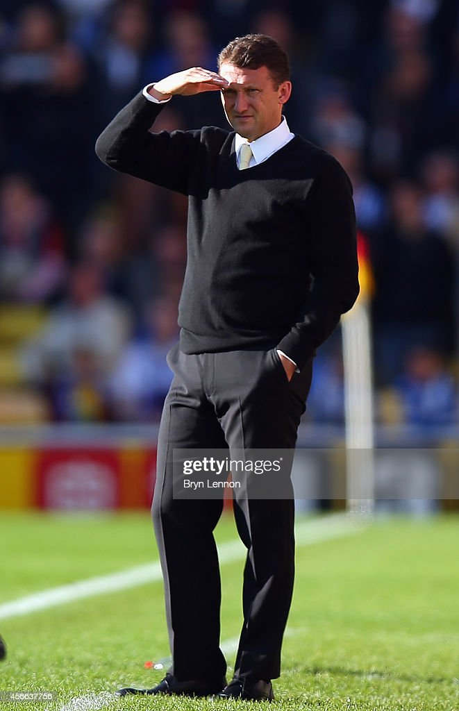 Watford Head Coach <a gi-track='captionPersonalityLinkClicked' href=/galleries/search?phrase=Billy+McKinlay&family=editorial&specificpeople=2992598 ng-click='$event.stopPropagation()'>Billy McKinlay</a> watches his team during the Sky Bet Championship match between Watford and Brighton & Hove Albion at Vicarage Road on October 4, 2014 in Watford, England.
