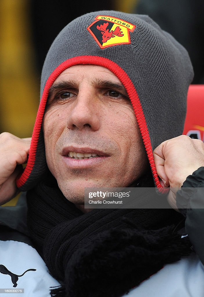 Watford manager <a gi-track='captionPersonalityLinkClicked' href=/galleries/search?phrase=Gianfranco+Zola&family=editorial&specificpeople=213951 ng-click='$event.stopPropagation()'>Gianfranco Zola</a> puts his hat on during the npower Championship match between Watford and Bolton Wanderers at Vicarage Road on February 02, 2013 in Watford England.