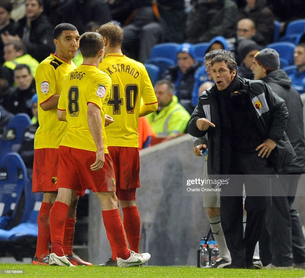 Watford manager <a gi-track='captionPersonalityLinkClicked' href=/galleries/search?phrase=Gianfranco+Zola&family=editorial&specificpeople=213951 ng-click='$event.stopPropagation()'>Gianfranco Zola</a> talks to his players during the npower Championship match between Brighton & Hove Albion and Watford at The Amex Stadium on December 29, 2012 in Brighton England.