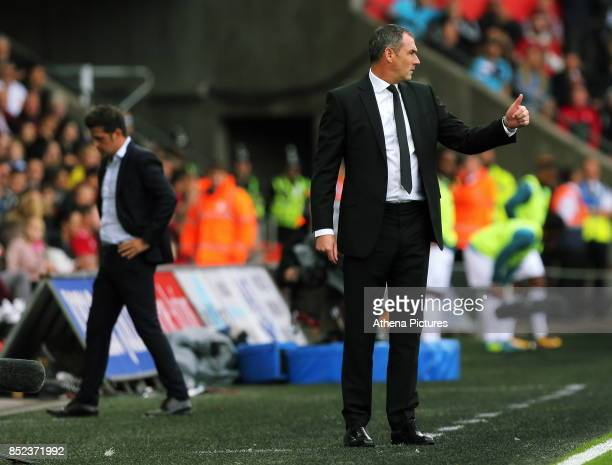 Watford manager Marco Silva and Swansea manager Paul Clement who gives the thumbs up to his players during the Premier League match between Swansea...