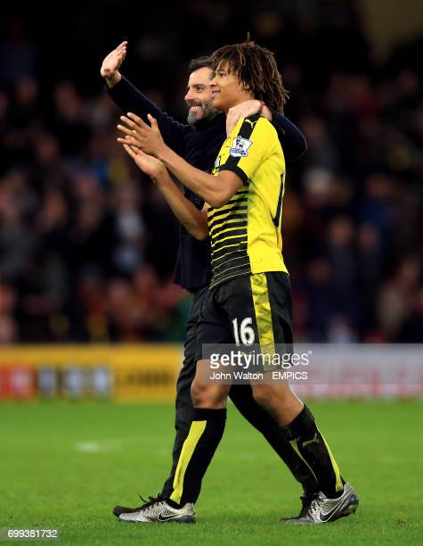 Watford manager Quique Flores and Nathan Ake acknowledge the fans after the game