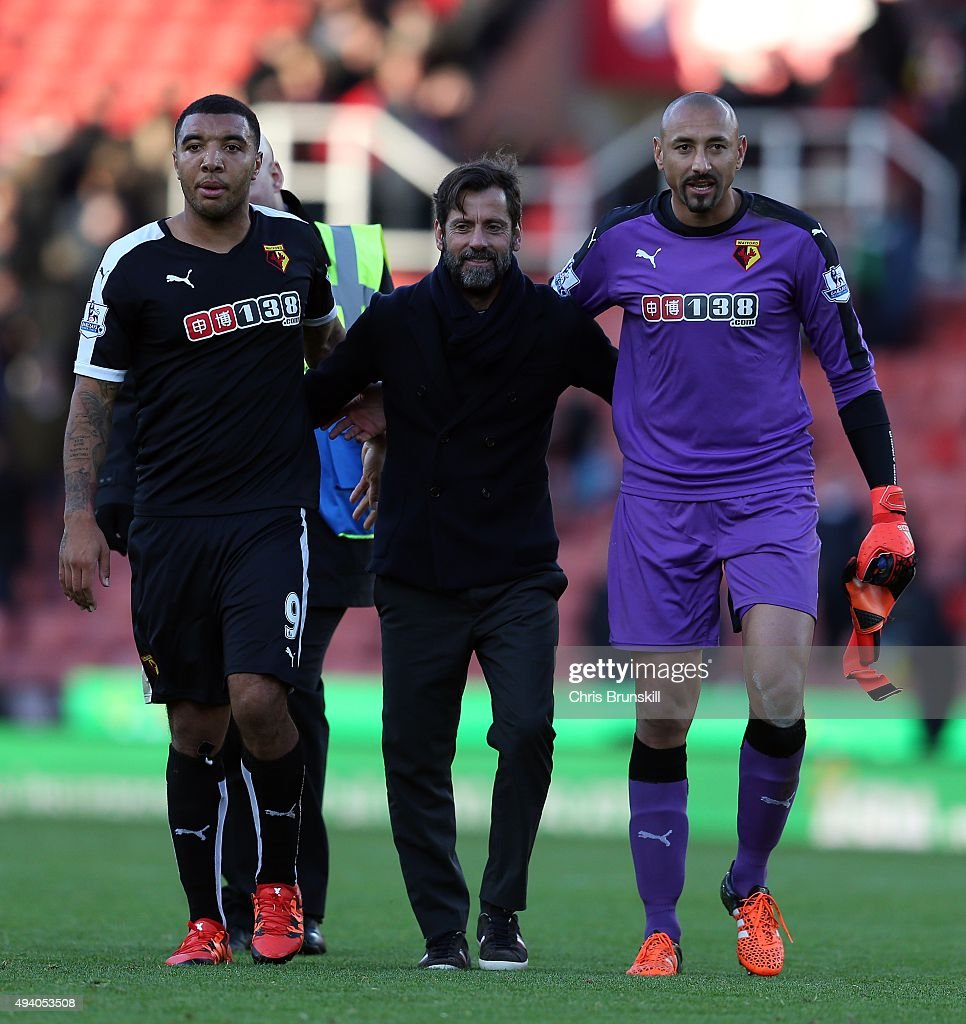 Watford manager Quique Sanchez Flores (C) celebrates at full-time with Troy Deeney (L) and Heurelho Gomes following the Barclays Premier League match between Stoke City and Watford on October 24, 2015 in Stoke on Trent, England.