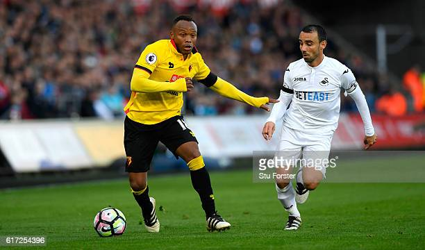Watford player Juan Zuniga outpaces Leon Britton of Swansea during the Premier League match between Swansea City and Watford at Liberty Stadium on...