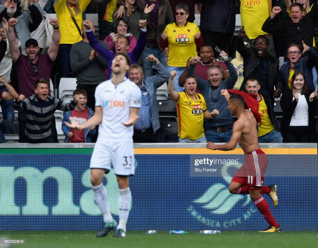 Watford player Richarlison celebrates the winning goal as Federico Fernandez of Swansea reacts during the Premier League match between Swansea City and Watford at Liberty Stadium on September 23, 2017 in Swansea, Wales.