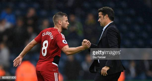 Watford player Tom Cleverley is congratulated by manager Marco Silva after the Premier League match between West Bromwich Albion and Watford at The...