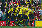 Watford players celebrate their team's first goal by Odion Ighalo during the Barclays Premier League match between Watford and West Ham United at...