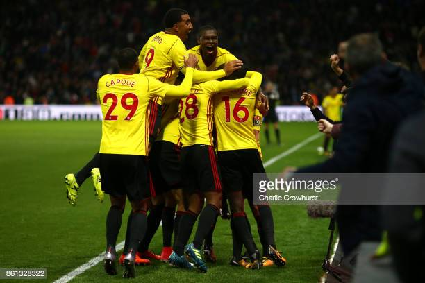 Watford players celebrate Tom Cleverley's late winning goal during the Premier League match between Watford and Arsenal at Vicarage Road on October...