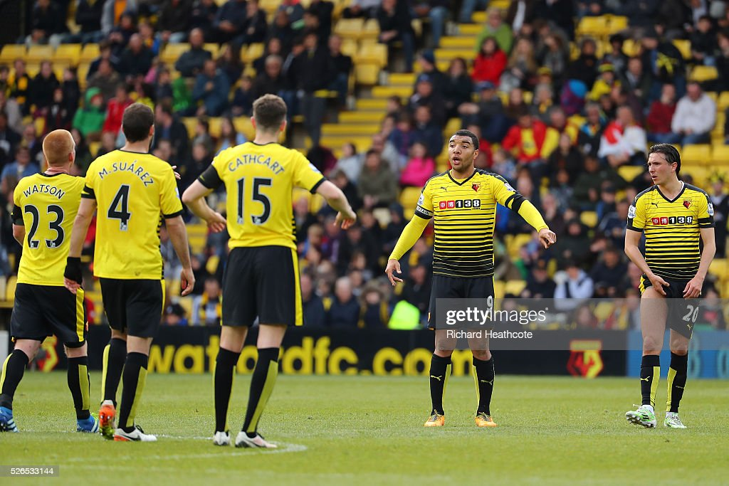 Watford players discuss during the Barclays Premier League match between Watford and Aston Villa at Vicarage Road on April 30, 2016 in Watford, England.