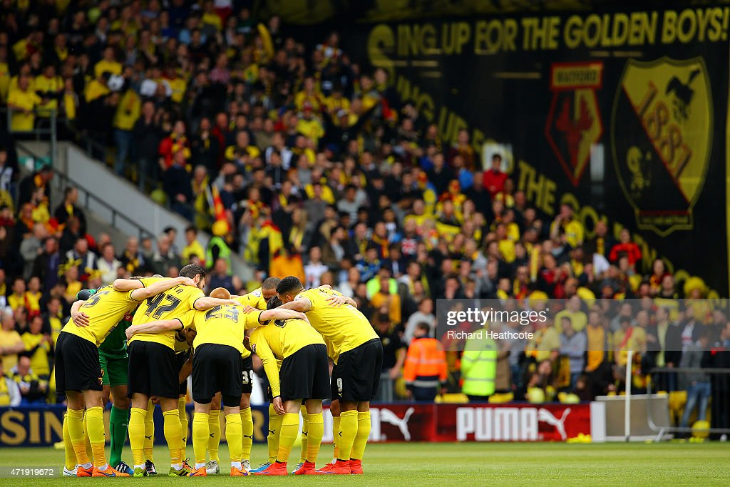 Watford players form a huddle prior to the Sky Bet Championship match between Watford and Sheffield Wednesday at Vicarage Road on May 2 2015 in...