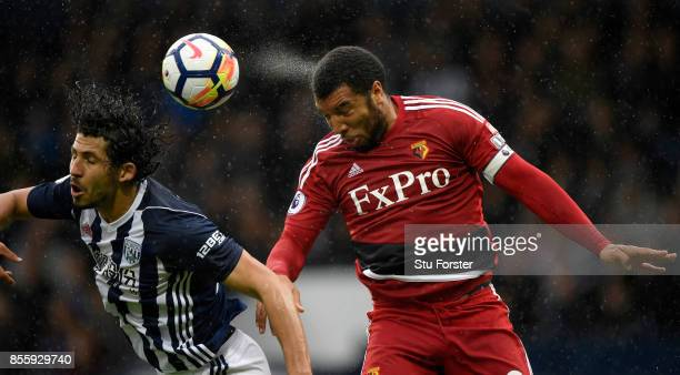 Watford striker Troy Deeney beats Ahmed Hegazi to the ball during the Premier League match between West Bromwich Albion and Watford at The Hawthorns...