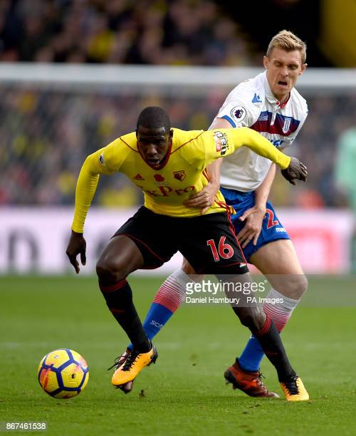 Watford's Abdoulaye Doucoure Stoke City's Darren Fletcher battle for the ball during the Premier League match at Vicarage Road Watford