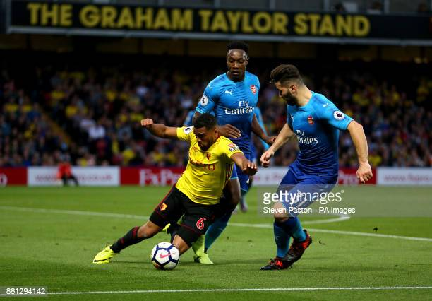 Watford's Adrian Mariappa and Arsenal's Sead Kolasinac and Danny Welbeck battle for the ball during the Premier League match at Vicarage Road Watford