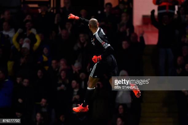 TOPSHOT Watford's Brazilian goalkeeper Heurelho Gomes celebrates after Watford's Brazilian striker Richarlison de Andrade scored their second goal...