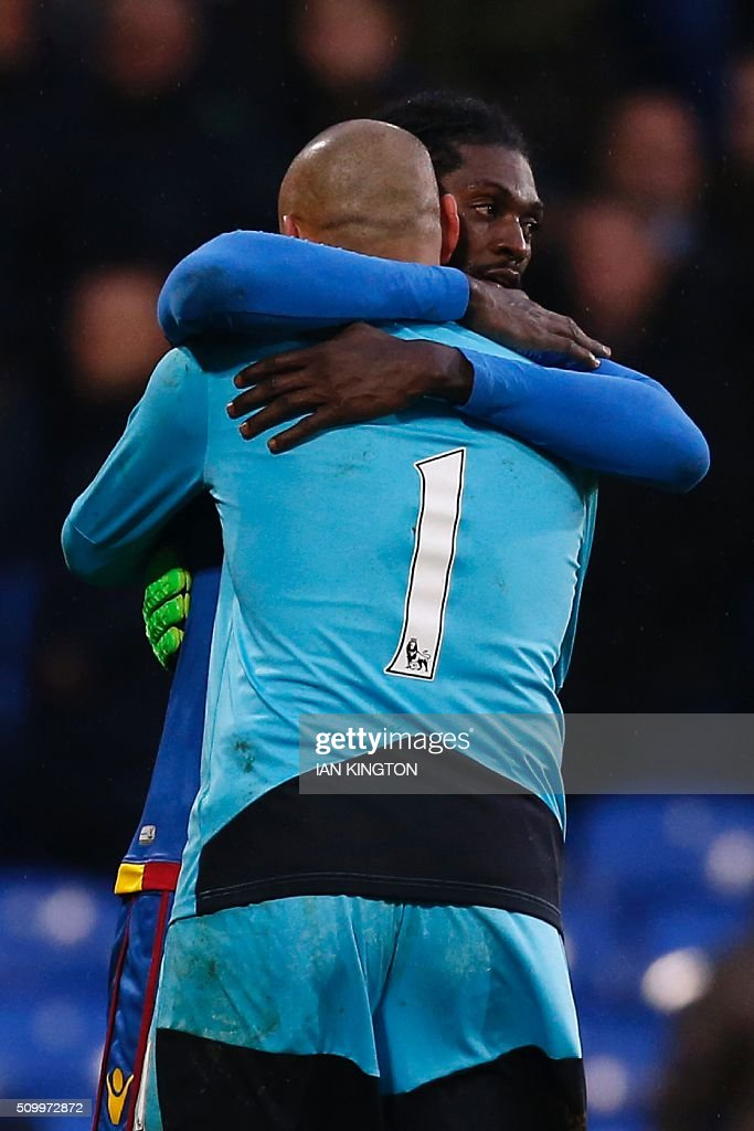 Watford's Brazilian goalkeeper Heurelho Gomes (L) embraces Crystal Palace's Togolese striker Emmanuel Adebayor (R) after the English Premier League football match between Crystal Palace and Watford at Selhurst Park in south London on February 13, 2016. / AFP / Ian Kington / RESTRICTED TO EDITORIAL USE. No use with unauthorized audio, video, data, fixture lists, club/league logos or 'live' services. Online in-match use limited to 75 images, no video emulation. No use in betting, games or single club/league/player publications. /