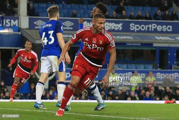 Watford's Brazilian striker Richarlison de Andrade celebrates scoring the opening goal during the English Premier League football match between...