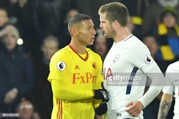 Watford's Brazilian striker Richarlison de Andrade confronts Tottenham Hotspur's English defender Eric Dier during the English Premier League...