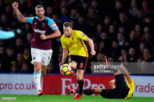 Watford's Brazilian striker Richarlison de Andrade goes down after being pushed in the back by West Ham United's English striker Andy Carroll an...