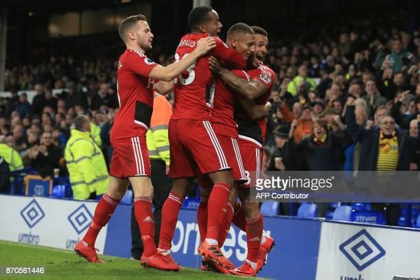 Watford's Brazilian striker Richarlison de Andrade is mobbed by teammates after scoring the opening goal during the English Premier League football...