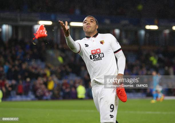 Watford's captain Troy Deeney throws his boots to Watford fans at the end of the game