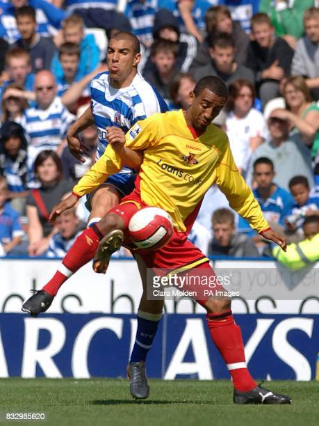 Watford's Cedric Avinel and Reading's James Harper battle for the ball