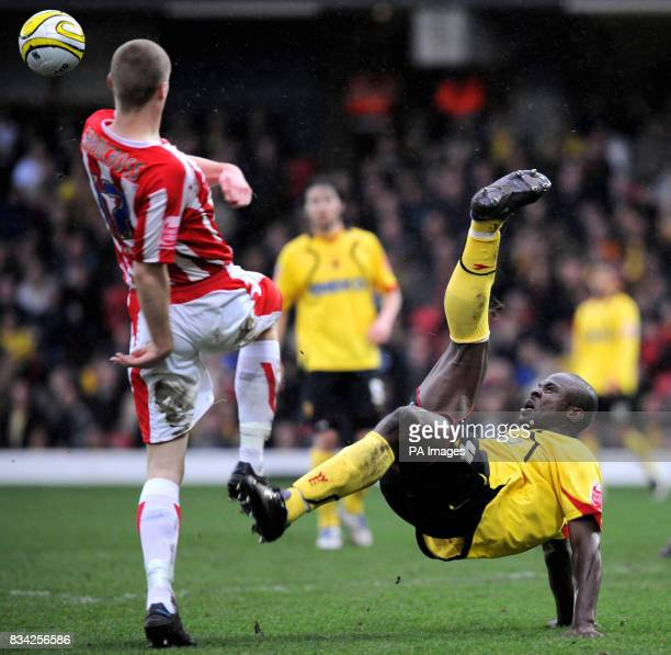 Watford's Dan Shittu and Stoke City's Ryan Shawcross battle for the ball during the CocaCola Championship match at Vicarage Road Watford