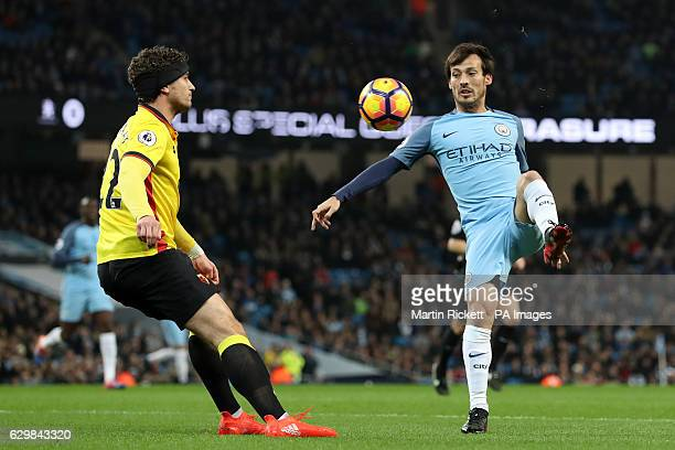 Watford's Daryl Janmaat and Manchester City's David Silva during the Premier League match at the Etihad Stadium Manchester