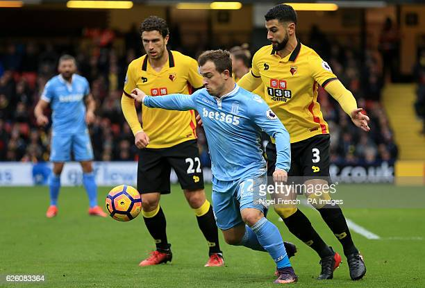 Watford's Daryl Janmaat and Miguel Britos battle for the ball with Stoke City's Xherdan Shaqiri during the Premier League match at Vicarage Road...