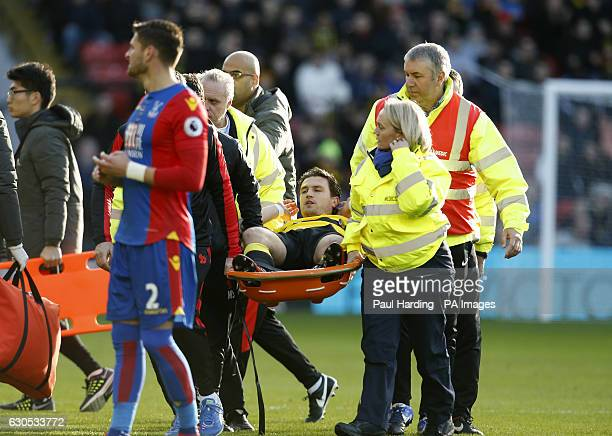 Watford's Daryl Janmaat is carried off the pitch in a stretcher after picking up an injury during the Premier League match at Vicarage Road Watford