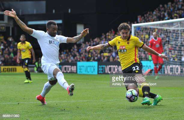 Watford's Daryl Janmaat under pressure from Swansea City's Jordan Ayew during the Premier League match between at Vicarage Road on April 15 2017 in...