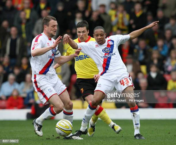 Watford's Don Cowie is stopped by Crystal Palace's Nathan Clyne and Clint Hill during the CocaCola Championship match at Vicarage Road Watford