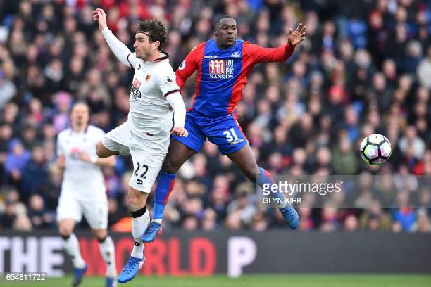 Watford's Dutch defender Daryl Janmaat vies with Crystal Palace's German defender Jeffrey Schlupp during the English Premier League football match...