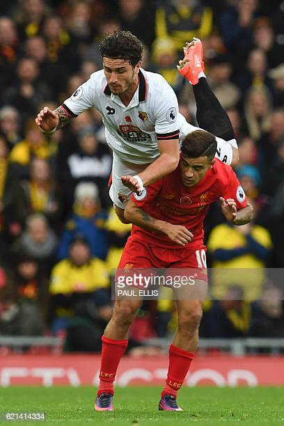 Watford's Dutch defender Daryl Janmaat vies with Liverpool's Brazilian midfielder Philippe Coutinho during the English Premier League football match...