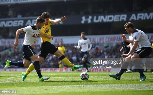 Watford's Dutch defender Daryl Janmaat vies with Tottenham Hotspur's Welsh defender Ben Davies and Tottenham Hotspur's Belgian defender Jan...