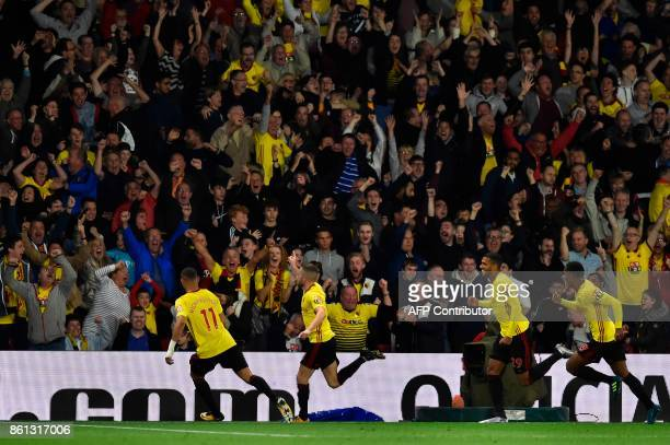 Watford's English mifielder Tom Cleverley celebrates scoring a late winning goal during the English Premier League football match between Watford and...