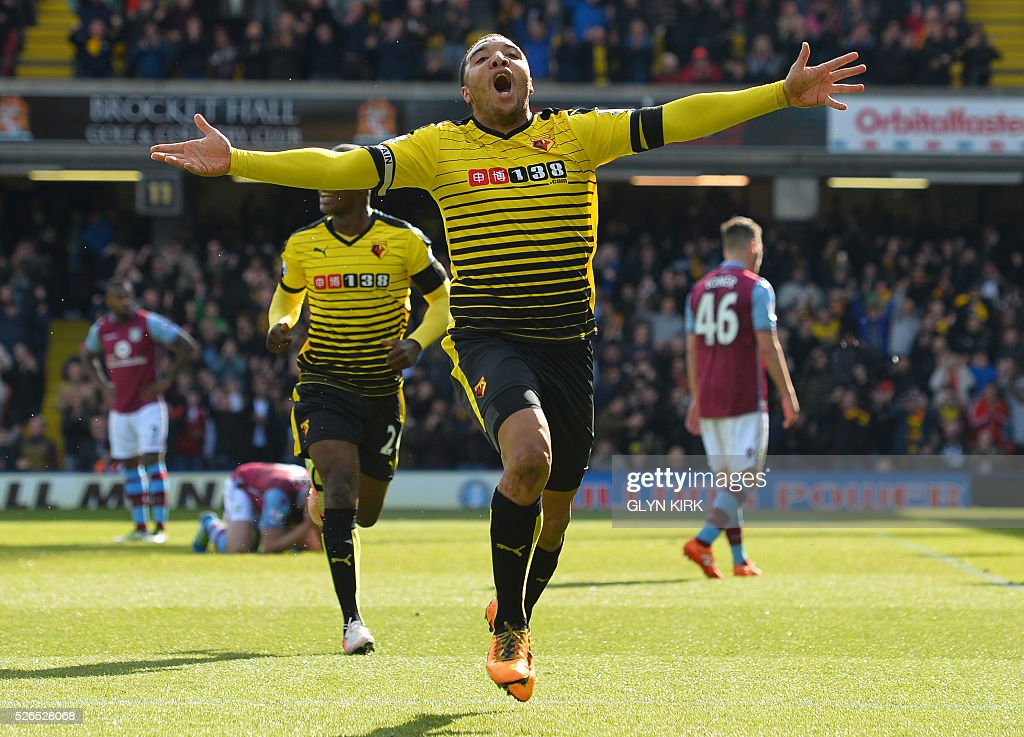 Watford's English striker Troy Deeney celebrates after scoring his second goal during the English Premier League football match between Watford and Aston Villa at Vicarage Road Stadium in Watford, north of London on April 30, 2016. / AFP / GLYN KIRK / RESTRICTED TO EDITORIAL USE. No use with unauthorized audio, video, data, fixture lists, club/league logos or 'live' services. Online in-match use limited to 75 images, no video emulation. No use in betting, games or single club/league/player publications. /