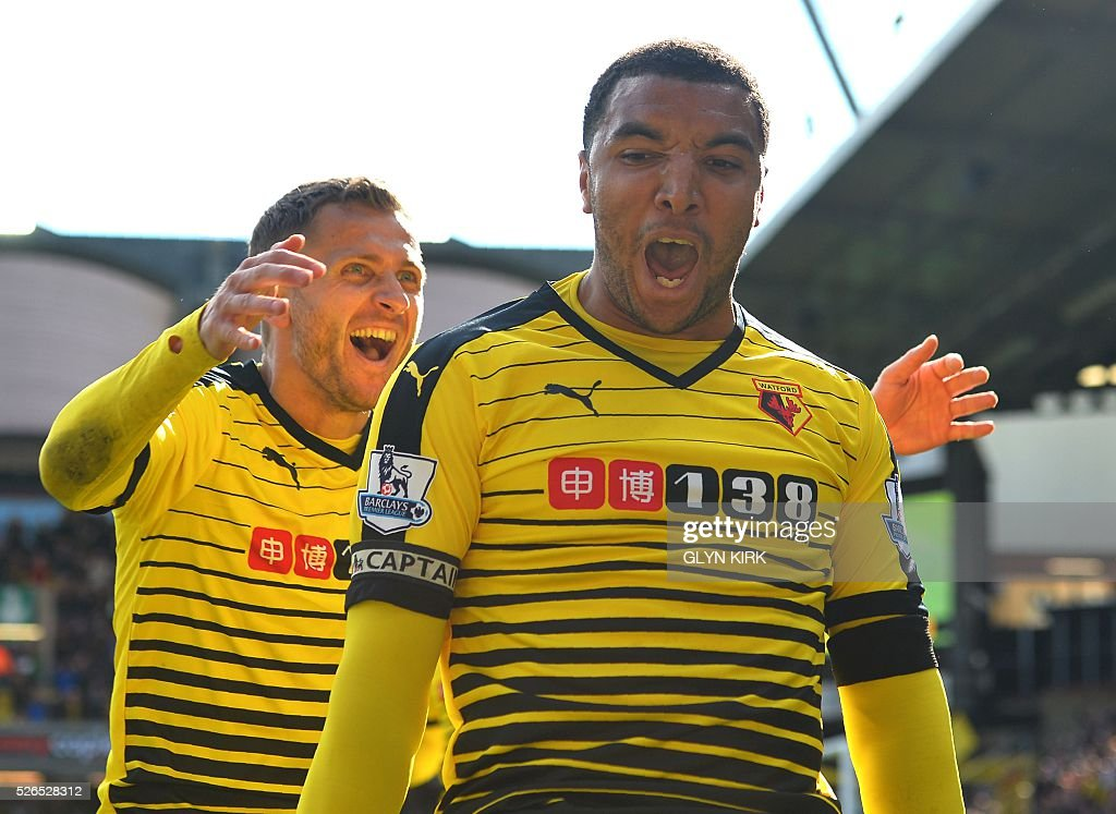 Watford's English striker Troy Deeney (R) celebrates after scoring his second goal during the English Premier League football match between Watford and Aston Villa at Vicarage Road Stadium in Watford, north of London on April 30, 2016. / AFP / GLYN KIRK / RESTRICTED TO EDITORIAL USE. No use with unauthorized audio, video, data, fixture lists, club/league logos or 'live' services. Online in-match use limited to 75 images, no video emulation. No use in betting, games or single club/league/player publications. /