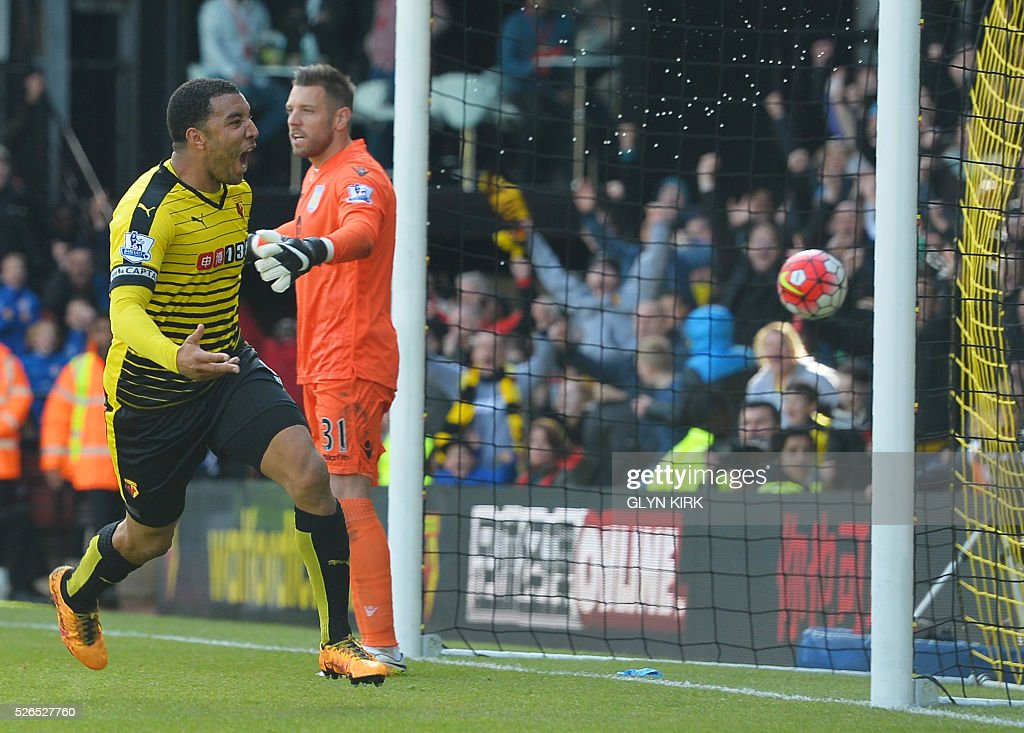 Watford's English striker Troy Deeney (L) celebrates after scoring past Aston Villa's English goalkeeper Mark Bunn during the English Premier League football match between Watford and Aston Villa at Vicarage Road Stadium in Watford, north of London on April 30, 2016. / AFP / GLYN KIRK / RESTRICTED TO EDITORIAL USE. No use with unauthorized audio, video, data, fixture lists, club/league logos or 'live' services. Online in-match use limited to 75 images, no video emulation. No use in betting, games or single club/league/player publications. /