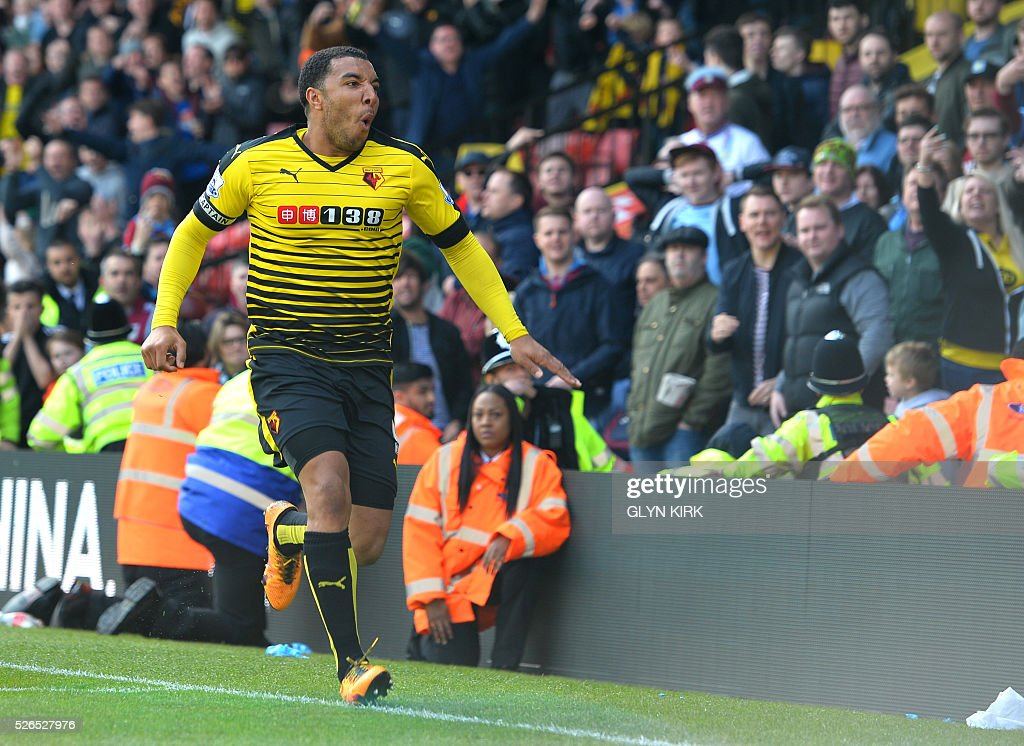 Watford's English striker Troy Deeney celebrates after scoring their second goald during the English Premier League football match between Watford and Aston Villa at Vicarage Road Stadium in Watford, north of London on April 30, 2016. / AFP / GLYN KIRK / RESTRICTED TO EDITORIAL USE. No use with unauthorized audio, video, data, fixture lists, club/league logos or 'live' services. Online in-match use limited to 75 images, no video emulation. No use in betting, games or single club/league/player publications. /