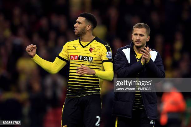 Watford's Etienne Capoue and Almen Abdi celebrate after the game